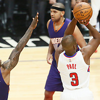 31 October 2016: Los Angeles Clippers guard Chris Paul (3) takes a jump shot past Phoenix Suns guard Eric Bledsoe (2) during the Los Angeles Clippers 116-98 victory over the Phoenix Suns, at the Staples Center, Los Angeles, California, USA.