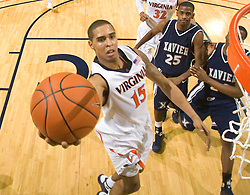 Virginia guard Sylven Landesberg (15) shoots a layup past Xavier guard Dante Jackson (25).  The #22 ranked Xavier Musketeers defeated the Virginia Cavaliers 84-70 at the John Paul Jones Arena on the Grounds of the University of Virginia in Charlottesville, VA on January 3, 2009.