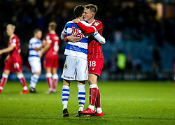 Jack Robinson of Queens Park Rangers hugs Cauley Woodrow of Bristol City after the game ends in a 1-1 draw - Rogan/JMP - 23/12/2017 - Loftus Road - London, England - Queens Park Rangers v Bristol City - Sky Bet Championship.