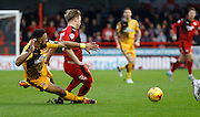 Leon Legge of Cambridge United gets a strong tackle in on Lee Barnard of Crawley Town during the Sky Bet League 2 match between Crawley Town and Cambridge United at the Checkatrade.com Stadium, Crawley, England on 9 January 2016. Photo by Andy Walter.