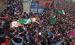 August 14, 2017 - India - People carry the dead body of chief operational commander of Hizbul Mujahideen militant outfit Yasin Itoo alias Mehmood Gaznavi in Chadoora some 30 kilometers from Srinagar the summer capital of Indian controlled Kashmir on August 14, 2017. Yasin the longest surviving militant and active from 1997 in Kashmir took the command of Hizbul Mujahideen after the death of its commander Burhan Muzafar Wani in July 2016. Three militants, two army soldiers and two civilians were killed while five soldiers sustained injuries in an 18-hour-long gunfight between government forces and militants in Awneera village of south Kashmir's Shopian district on Sunday August 13, police and reports said. (Credit Image: © Faisal Khan/Pacific Press via ZUMA Wire)