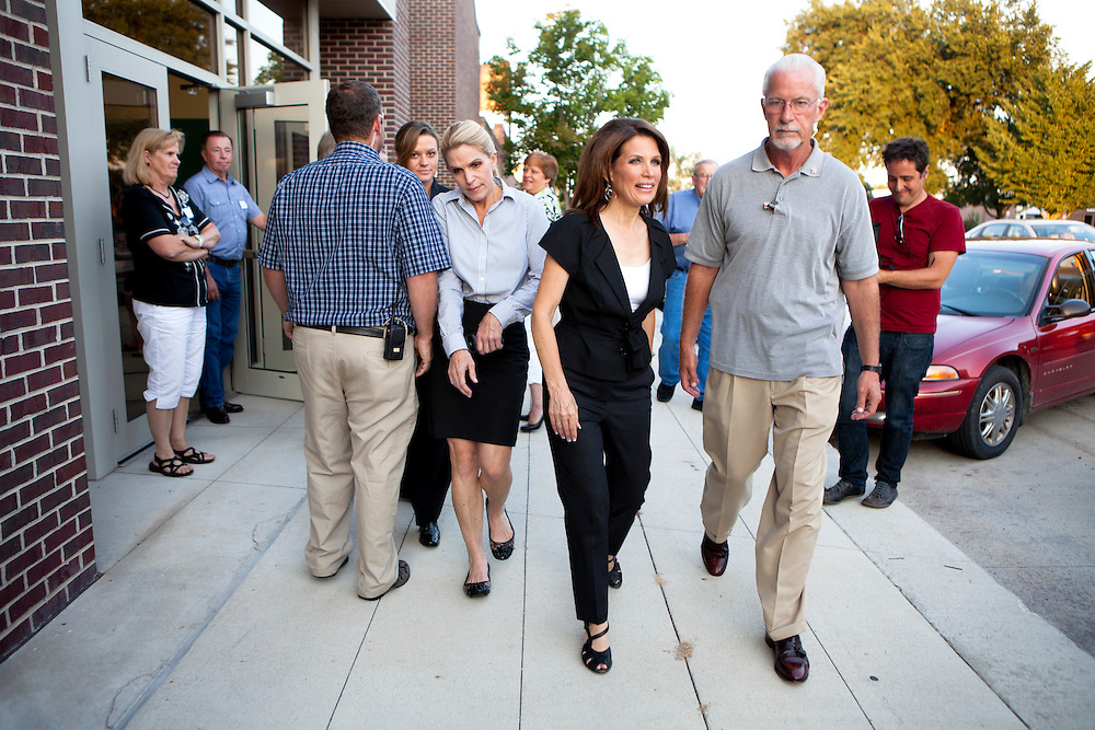 Republican presidential candidate Rep. Michele Bachmann (R-MN), center, leaves a campaign stop at the Calhoun County Republican Party dinner on Monday, August 8, 2011 in Rockwell City, IA.