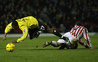 Fotball<br /> England 2004/2005<br /> Foto: SBI/Digitalsport<br /> NORWAY ONLY<br /> <br /> Date: 04/12/2004<br /> <br /> Watford v Stoke City <br /> Coca Cola Championship<br /> <br /> Ashley Young of Watford is sent flying by Stoke's Darel Russell