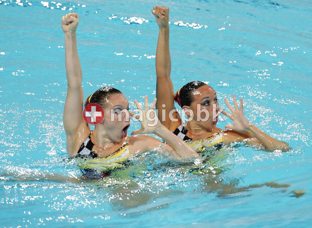Swiss swimmers Magdalena Brunner and Belinda Schmid participate in the Synchronised Swimming Pool Duet Technical Routine of the Athens 2004 Olympic Games at the Olympic Aquatic Centre in Athens Monday 23 August 2004.  ........ (Photo by Patrick B. Kraemer / MAGICPBK)