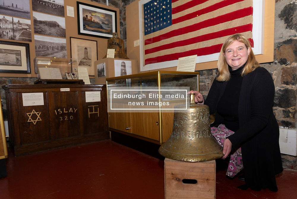 The ship's bell belonging to the SS Otranto which was sunk in Machir Bay off the coast of the Scottish island of Islay has gone on display in the Museum of Islay Life in Port Charlotte.<br /> <br /> The Otranto sunk on 6 October 1918 and a commemoration will take place on the island to mark the centenary this coming October. It is hoped that the bell, which has been loaned to the museum by the diver who found it at the bottom of the bay, will form part of the ceremony.<br /> <br /> Pictured: Museum manager, Jenni Minto with the bell of the SS Otranto. In the background is a flag that has been loaned to the museum by the Smithsonian museum and was made by five Islay residents in 1918.