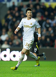 SWANSEA, WALES - Saturday, December 8, 2012: Swansea City's Ki Sung-Yeung in action against Norwich City during the Premiership match at the Liberty Stadium. (Pic by David Rawcliffe/Propaganda)