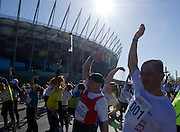 Trainer Henryk Ostrykiewicz and athlete Marian Gargula of Special Olympics attend a Warsaw Orlen Marathon on April 21, 2013..The mission of Special Olympics is to provide sports training and athletic competition for children and adults with intellectual disabilities...Poland, Warsaw, April 21, 2013..Picture also available in RAW (NEF) or TIFF format on special request...For editorial use only. Any commercial or promotional use requires permission...Photo by © Adam Nurkiewicz / Mediasport