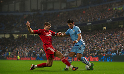 11.01.2012, Etihad Stadion, Manchester, ENG, Carling Cup, Manchester City vs FC Liverpool, Halbfinale, im Bild Liverpool's captain Steven Gerrard in action against Manchester City's Sergio Aguero during the football match of English Carling Cup, Halffinal, between Manchester City and FC Liverpool at Etihad Stadium, Manchester, United Kingdom on 2012/01/11. EXPA Pictures © 2012, PhotoCredit: EXPA/ Propagandaphoto/ David Rawcliff..***** ATTENTION - OUT OF ENG, GBR, UK *****