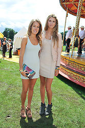 Left to right, the HON.EMILY PEARSON and SABRINA PERCY at the 2012 Veuve Clicquot Gold Cup Final at Cowdray Park, Midhurst, West Sussex on 15th July 2012.