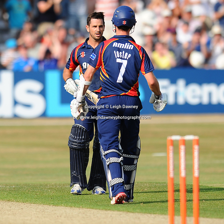 "Ryan Ten Doeschate shares congratulations with James Foster (both of Essex) after winning the Friends Life T20 between Essex ""Eagles"" v Sussex ""Sharks"". at the Essex County Cricket Ground on the 14th July 2013. Credit: © Leigh Dawney Photography. Self Billing where applicable. Tel: 07812 790920"