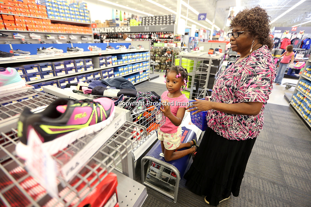 Galiyn White, 6, shops with her grandmother Flora Freeman, for shoes, socks and other items at Academy Sports on Thursday morning in Tupelo. Galiyn is one of thirty children from Tupelo Parks and Recreation that received a $100.00 Academy gift card to help their back-to-school shopping easier.