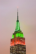 New York City. The Empire State Building illuminated Red and Green for the Christmas Season.