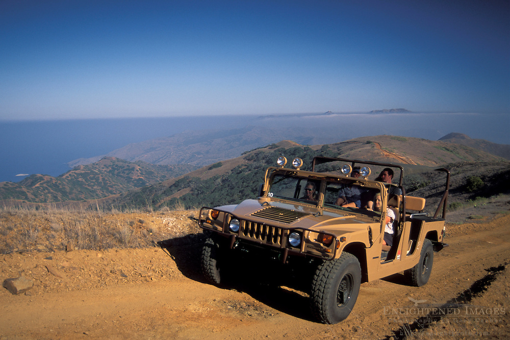 Hummer SUV transportation vehicle takes tourists on driving tour through hills of Catalina Island, California Coast