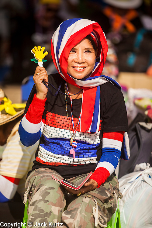 17 FEBRUARY 2014 - BANGKOK, THAILAND: An anti-government protestor cheers for Suthep Thaugsuban, leader of the protest movement, at Government House. The anti-government protest movement, led by the People's Democratic Reform Committee and called Shutdown Bangkok has been going on for more than a month. The protest movement called, the People's Democratic Reform Committee (PDRC), wants to purge the current ruling party and its patrons in the Shinawatra family from Thai politics. The movement has consistently refused any dialogue or negotiations with the Pheu Thai ruling party. Over the weekend Thai police claimed to have taken the protest areas around Government House (the Prime Minister's office) away from protestors but on Monday protestors marched unimpeded to Government House and retook the area.   PHOTO BY JACK KURTZ