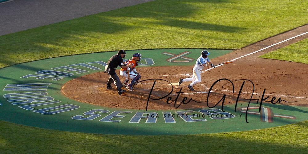 North Carolina's Mike Cavasinni drives a base hit up the middle against Clemson.  The North Carolina Tar Heels defeated Clemson 2-0 at the College World Series at Rosenblatt Stadium in Omaha, Nebraska, June 18, 2006.