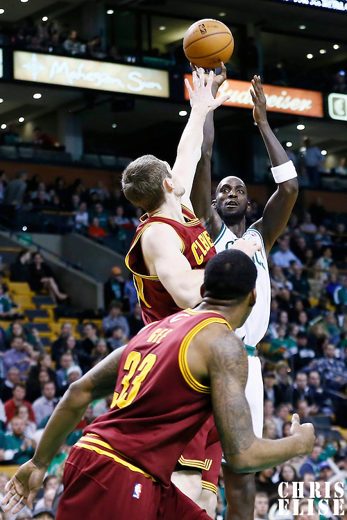 19 December 2012: Boston Celtics power forward Kevin Garnett (5) takes a jumpshot over Cleveland Cavaliers center Tyler Zeller (40) during the Boston Celtics 103-91 victory over the Cleveland Cavaliers at the TD Garden, Boston, Massachusetts, USA.