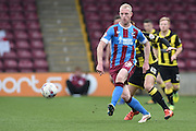 Neil Bishop of Scunthorpe United kicks forward during the Sky Bet League 1 match between Scunthorpe United and Burton Albion at Glanford Park, Scunthorpe, England on 9 April 2016. Photo by Ian Lyall.