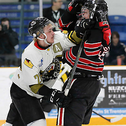 TRENTON, ON  - MAY 5,  2017: Canadian Junior Hockey League, Central Canadian Jr. &quot;A&quot; Championship. The Dudley Hewitt Cup. Game 7 between The Georgetown Raiders and The Powassan Voodoos.  Dayton Murray #20 of the Powassan Voodoos and Jordan Anderson #25 of the Georgetown Raiders battle for position during the second period <br /> (Photo by Amy Deroche / OJHL Images)