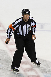 Dec 1, 2011; San Jose, CA, USA; NHL referee Brian Pochmara (16) before a face off between the San Jose Sharks and the Montreal Canadiens during overtime at HP Pavilion.  San Jose defeated Montreal 4-3 in shootouts. Mandatory Credit: Jason O. Watson-US PRESSWIRE