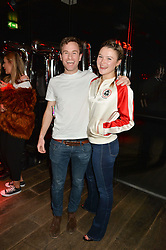 GUY SHAW-STEWART and AMBER ATHERTON at a party to celebrate the launch of the Beth Ditto Clothing Line held at The London Edition, Berners Street, London on 18th February 2016.