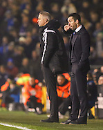 Nathan Jones Manager of Brighton and Hove Albion (right) bites his nails as he looks on with Kit Symons Manager of Fulham (2nd right) during the Sky Bet Championship match at Craven Cottage, London<br /> Picture by David Horn/Focus Images Ltd +44 7545 970036<br /> 29/12/2014