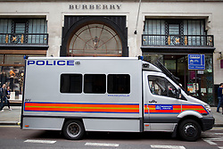 © Licensed to London News Pictures. 11/06/2013. London, UK. A police van is seen outside the Burberry shop on Regent Street as part of preparations for a demonstration  in London today (11/06/2013). The the small demonstration, part of an organised anti-capitalist protest in central London, were time to coincide with the G8 meeting of world leaders in Northern Ireland this week. Photo credit: Matt Cetti-Roberts/LNP