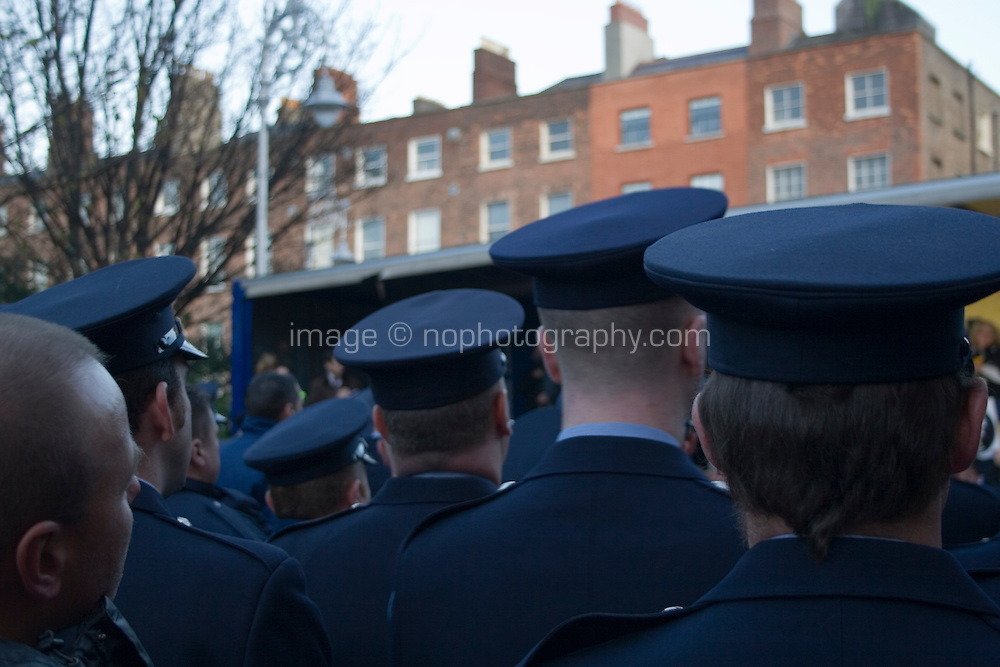 Gardaí amongst protesters marching in Dublin Ireland as part of a campaign organised by the Irish Congress of Trade Unions