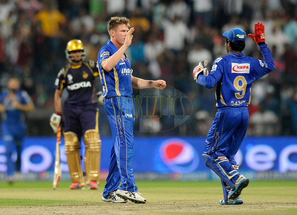 James Faulkner of the Rajatshan Royals celebrates the wicket of Vinay Kumar of the Kolkata Knight Riders during match 19 of the Pepsi Indian Premier League 2014 Season between The Kolkata Knight Riders and the Rajasthan Royals held at the Sheikh Zayed Stadium, Abu Dhabi, United Arab Emirates on the 29th April 2014<br /> <br /> Photo by Pal Pillai / IPL / SPORTZPICS