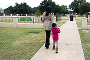 Tammy Simpson and her daughter Ryan visit the grave site of her son, Troy E. Causey, Jr. who was killed on March 24, 2014 in Dallas, Texas on November 14, 2014.