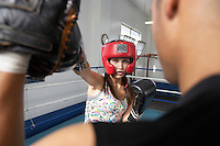 Man and woman training in boxing ring