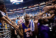 Kobe Bryant high-fives fans as he leaves the court after the Lakers' 98-80 victory to defeat the New Orleans Hornets in six games during their NBA Playoff series Thursday April 28th 2011.