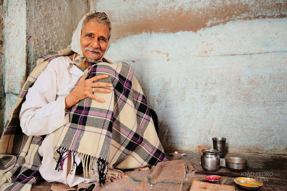 ELderly man giving blessings outside temple