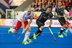 England's Nick Catlin is watched by Benedikt Fuerk of Germany. England v Germany - Semi-Final Unibet EuroHockey Championships, Lee Valley Hockey & Tennis Centre, London, UK on 27 August 2015. Photo: Simon Parker