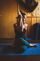 Alli Rainey practicing yoga in her home studio, Ten Sleep, Wyoming.
