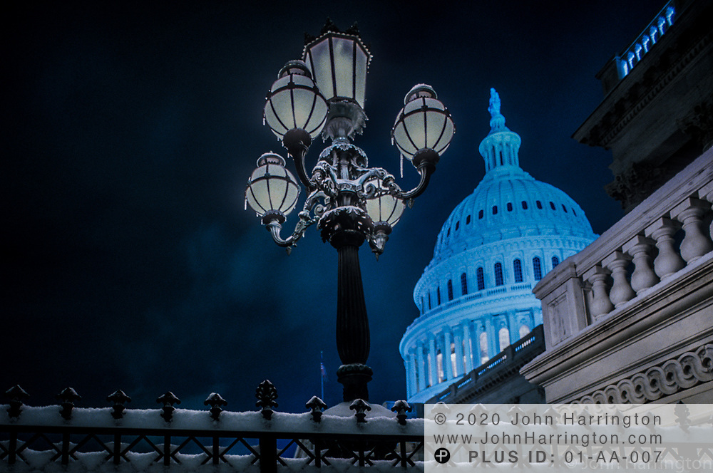 The US Capitol at night during the winter.