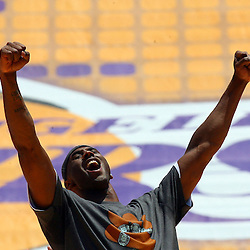 Lakers Kobe Bryant celebrates as he was introduced to the 90 thousand plus fans during the victory rally for the World Champion Los Angeles Lakers at the Los Angeles Memorial Coliseum on Wednesday June 17, 2009 in Los Angeles. (SGVN/Staff Photo by Keith Birmingham/SPORTS)