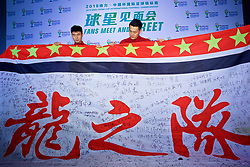 NANNING, CHINA - Saturday, March 24, 2018: China's Deng Hanwen and Wang Dalei are presented with a flag by supporters during a meet & greet event at the Nanning Wanda Mall during the 2018 Gree China Cup International Football Championship. (Pic by David Rawcliffe/Propaganda)