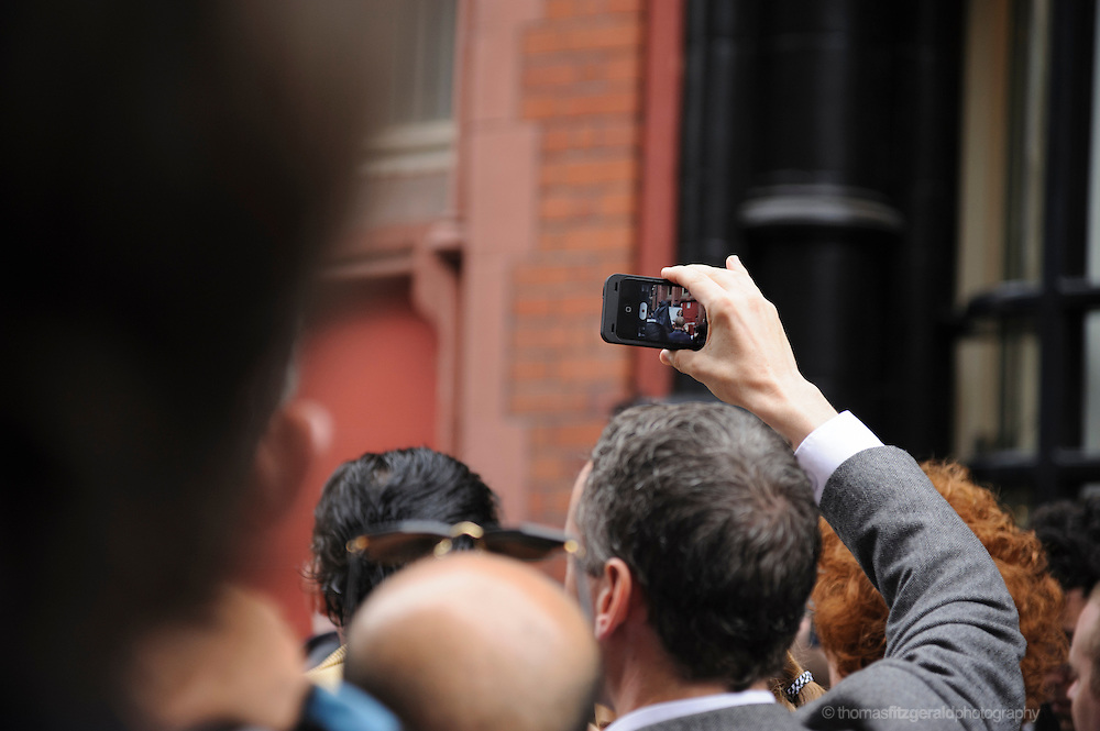 People looking through their smartphones at Phil Lynott Statue Unveiling<br /> <br /> The Statue is being unveiled, having being repaired following damage by vandals earlier this year. Several musicians played at the event and the star's mother, Philimena Lynott gave a moving speech about her Son and the Statue. EDITORIAL ONLY