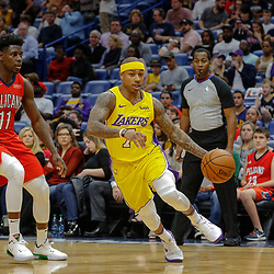 Feb 14, 2018; New Orleans, LA, USA; Los Angeles Lakers guard Isaiah Thomas (7) drives past New Orleans Pelicans guard Jrue Holiday (11) during the first quarter at the Smoothie King Center. Mandatory Credit: Derick E. Hingle-USA TODAY Sports