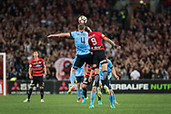 October 08, 2016: Sydney FC defender Alex WILKINSON (4) and Western Sydney Wanderers forward Kerem BULUT (9) fight for the ball at Round 1 of the 2016 Hyundai A-League match, between Western Sydney Wanderers and Sydney FC, played at ANZ Stadium in Sydney. Sydney FC won the game 4-0.