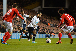 Tottenham's Aaron Lennon runs with the ball at Cardiff's Kim Bo-Kyung  - Photo mandatory by-line: Mitchell Gunn/JMP - Tel: Mobile: 07966 386802 02/03/2014 - SPORT - FOOTBALL - White Hart Lane - London - Tottenham Hotspur v Cardiff City - Premier League