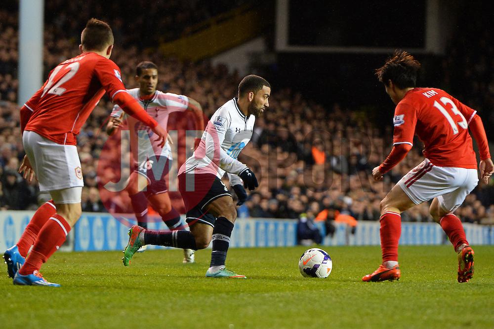 Tottenham's Aaron Lennon runs with the ball at Cardiff's Kim Bo-Kyung  - Photo mandatory by-line: Mitchell Gunn/JMP - Tel: Mobile: 07966 386802 02/03/2014 - SPORT - FOOTBALL - White Hart Lane - London - Tottenham Hotspur v Cardiff City - Premier League