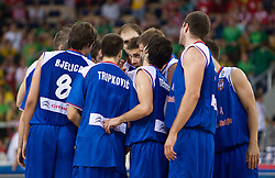 Team of Serbia celebrates after the EuroBasket 2009 Group F match between Serbia and Lithuania, on September 16, 2009 in Arena Lodz, Hala Sportowa, Lodz, Poland.  (Photo by Vid Ponikvar / Sportida)