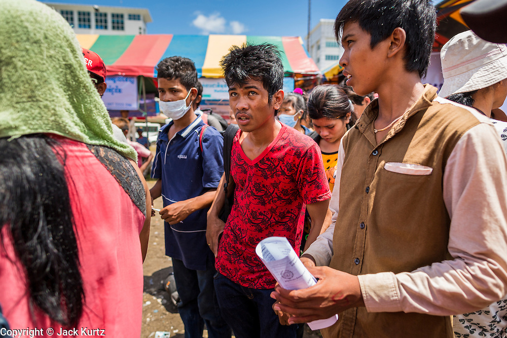 16 JUNE 2014 - POIPET, CAMBODIA: A Cambodian migrants in Poipet, Cambodia after he returned to Cambodia from Thailand. More than 150,000 Cambodian migrant workers and their families have left Thailand since June 12. The exodus started when rumors circulated in the Cambodian migrant community that the Thai junta was going to crack down on undocumented workers. About 40,000 Cambodians were expected to return to Cambodia today. The mass exodus has stressed resources on both sides of the Thai/Cambodian border. The Cambodian town of Poipet has been over run with returning migrants. On the Thai side, in Aranyaprathet, the bus and train station has been flooded with Cambodians taking all of their possessions back to Cambodia.  PHOTO BY JACK KURTZ