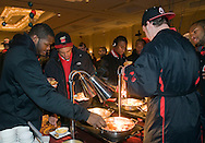 The University of Maryland football team enjoys a buffet during the Welcome reception at the Renaissance Hotel in Washington, DC, where they will be staying for the Military Bowl. They will face East Carolina University in the Military Bowl on December 29, 2010. (Photo by Alan Lessig)