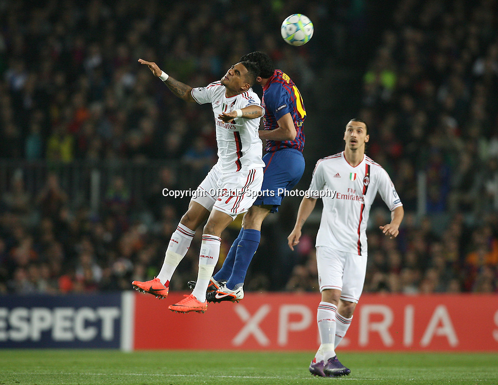 03/04/2012 - UEFA Champions League - Quarter Final (2nd Leg) - FC Barcelona vs. AC Milan - Kevin-Prince Boateng of Milan battles with Sergio Busquets of Barcelona - Photo: Simon Stacpoole / Offside.