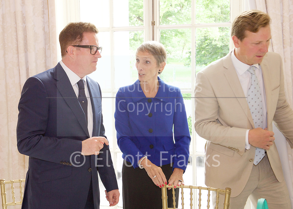 Today 24th June 2016, the President of the RAD, Darcey Bussell CBE, escorted Sir Matthew Bourne to Buckingham Palace to receive the Queen Elizabeth II Coronation (QEII) Award from Her Majesty The Queen.<br /> Internationally accepted as one of the most coveted honours in the world of dance, the QEII is the RAD's most prestigious award. It was instituted in 1953 to commemorate the coronation of Queen Elizabeth II and was first bestowed in 1954 to Dame Ninette De Valois. Since then it has been awarded nearly every year to personalities in recognition of outstanding services to the art of ballet. This year however, was the first time that the award has been presented by the Queen herself.<br /> <br /> After the presentation, Darcey Bussell hosted a champagne luncheon in honour of Sir Matthew in the ballroom of the Mandarin Oriental, Hyde Park. He was joined by the luminaries of the entertainment and dance world, including his own company dancers. Others in attendance were choreographer Arlene Phillips, Strictly judges Craig Revel Horwood and Bruno Tonioli, designer Jasper Conran and comedienne and actress Dawn French.<br /> <br /> Following a special ceremony in which Sir Matthew received a citation by New York Times dance critic Alistair Macaulay, students from the RAD also performed before presenting him with a print of a pair of red ballet shoes. The print, donated by Darcey Bussell, was signed by all guests in attendance as thanks to Sir Matthew ahead of the world premiere of his new ballet, The Red Shoes.<br /> <br /> This year the QEII award and its celebrations have been kindly sponsored by Coutts who have also supported the design and production of the medal itself, produced by Bigbury Mint.<br /> <br /> The RAD would also like to thank Bruno Wang and the Pure Land Foundation for their generous support, the Mandarin Oriental, and Mo&euml;t Hennessy for kindly providing Veuve Clicquot Champagne.