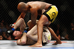 August 8, 2009; Philadelphia, PA; USA; Anderson Silva (black/yellow trunks) and Forrest Griffin (tan/brown trunks) battle during their UFC light heavyweight bout at the Wachovia Center in Philadelphia, PA.  Silva won via 1st round KO.