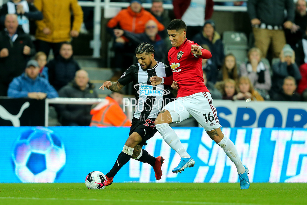 Marcos Rojo (#16) of Manchester United battles for possession of the ball with DeAndre Yedlin (#22) of Newcastle United during the Premier League match between Newcastle United and Manchester United at St. James's Park, Newcastle, England on 6 October 2019.