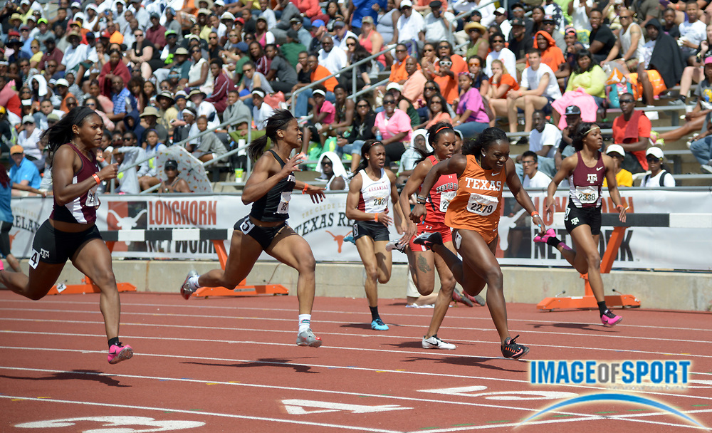 Mar 29, 2014; Austin, TX, USA; Morolake Akinosun of Texas (center) wins the womens 100m in a wind-aided 11.10 in the 87th Clyde Littlefield Texas Relays at Mike A. Myers Stadium. From left: Aaliyah Brown of Texas A&M and Shayla Sanders of Florida and Akinosun and Cierra White of Texas Tech and Ashton Purvis of Texas A&M.